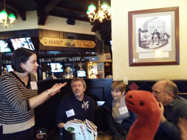 Liz MacDonald (Aurorasaurus founder) talking to the Alberta Aurora Chasers group with a special appearance by Rory, the Aurorasaurus mascot