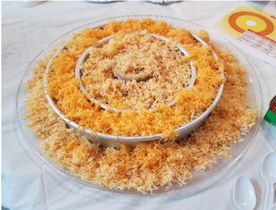 A tray holds four fluffy yellow layers of cheese in concentric containers.