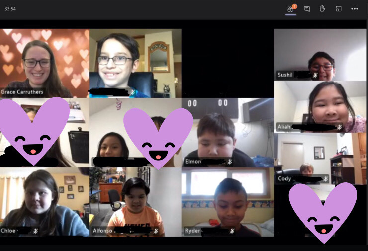 Students smile in a Zoom group screenshot