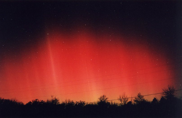 A red glow lights the sky